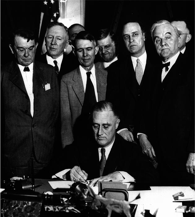 Roosevelt signing TVA Act (1933)