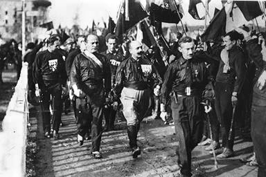 Benito Mussolini (2nd from left) and his Fascist Blackshirts in 1920