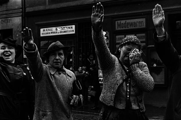 Ethnic Germans in the city of Sudetenland town of Cheb greet Hitler using the Nazi salute in 1938.